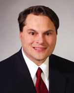 John M. Neclerio