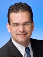 Joshua E. Menard